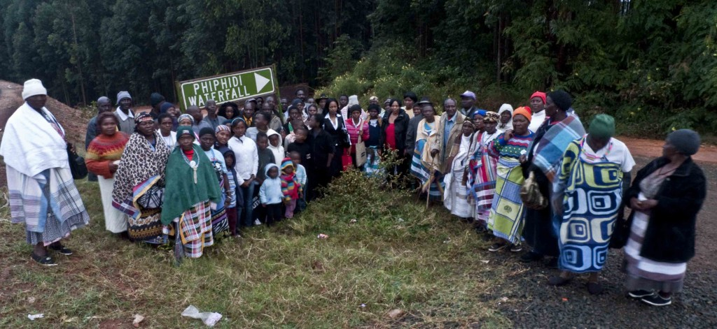 Members of Dzomo la Mupo gather outside the sealed-off Phiphidi Falls before marching on the gate to protest